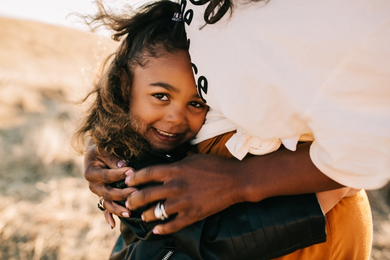 Family Photographer, close up of daughter hugging mother