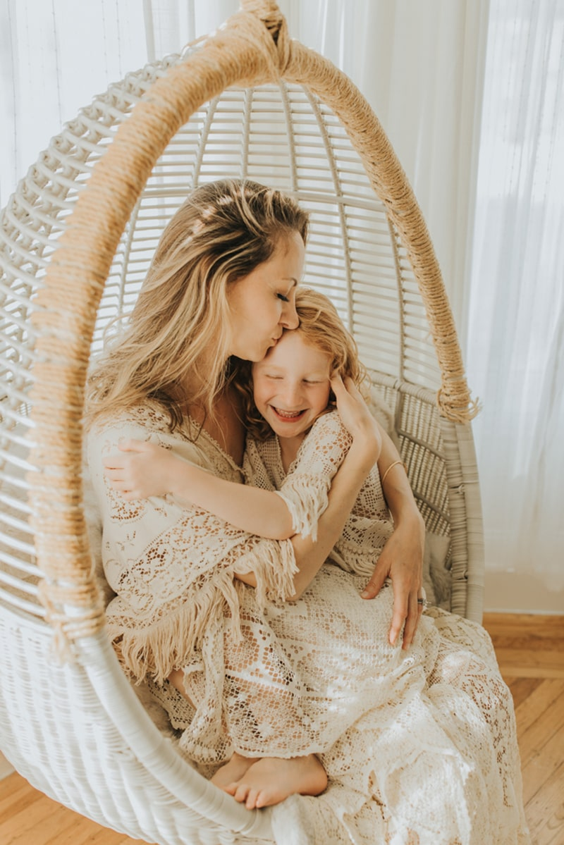 Family Photographer, mother and daughter sitting together in hanging chair