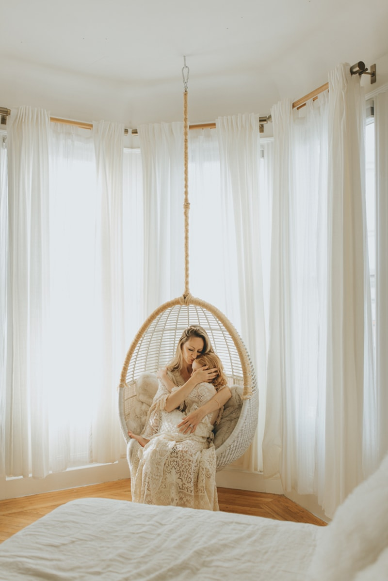Family Photographer, mother and daughter sitting together in a hanging chair