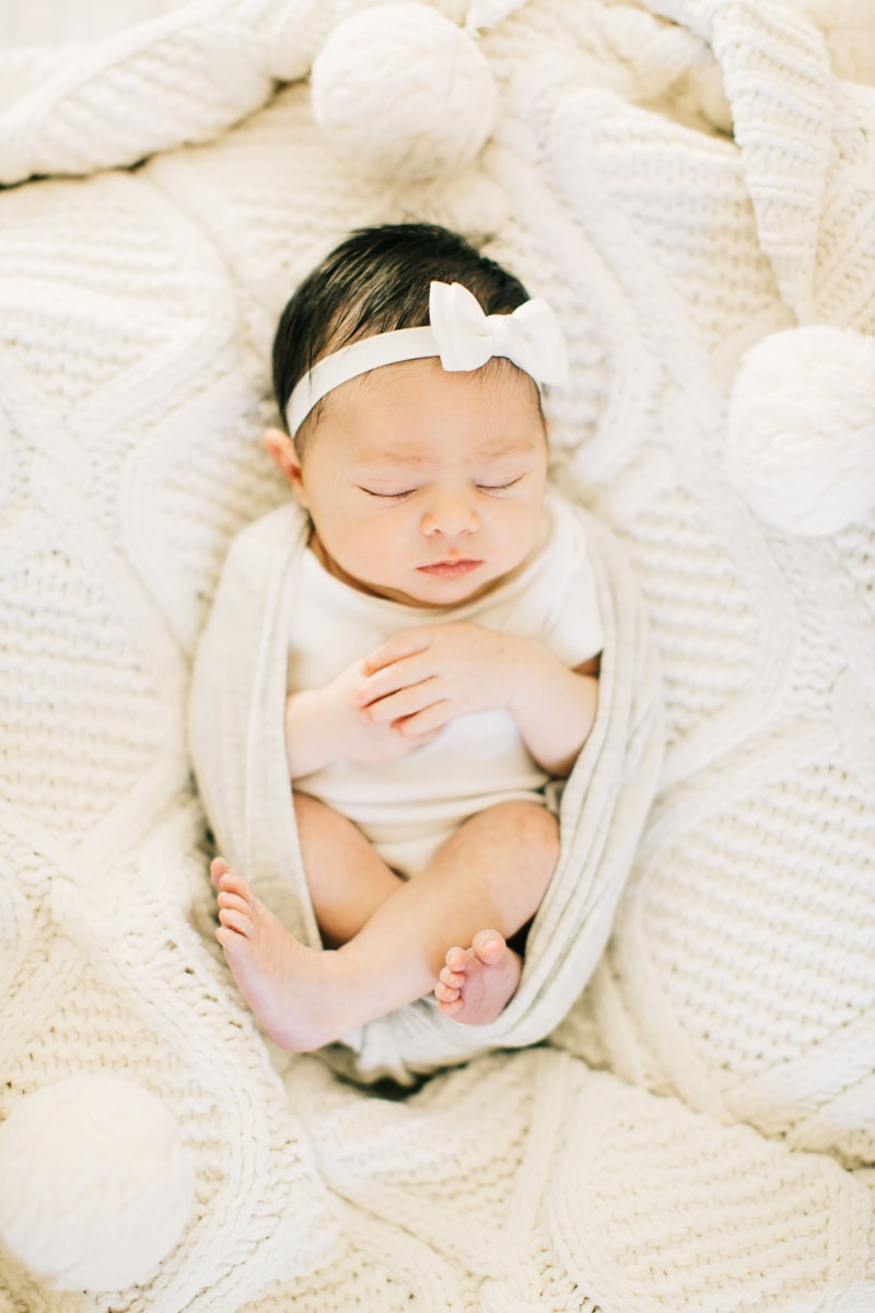 Newborn Photographer, baby asleep in white blankets