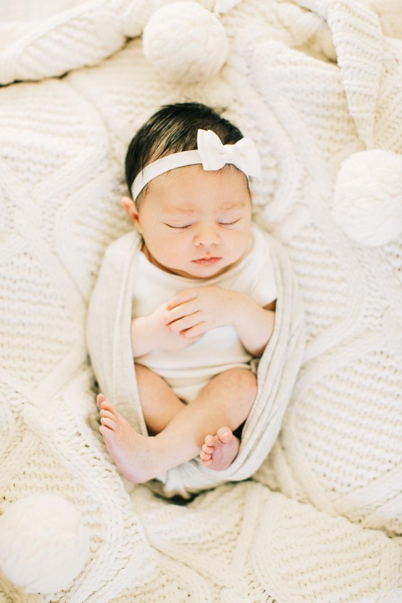 Newborn Photographer, baby asleep in white blankets