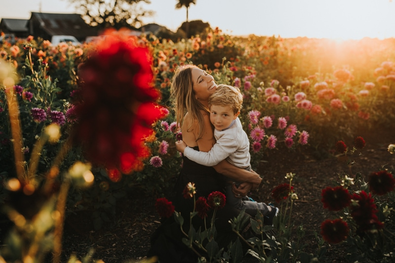 Family Photographer, mother and son sitting in a flower field