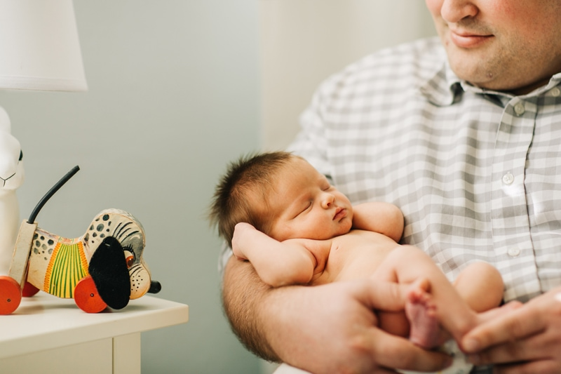 Newborn Photographer, baby asleep in dads arms