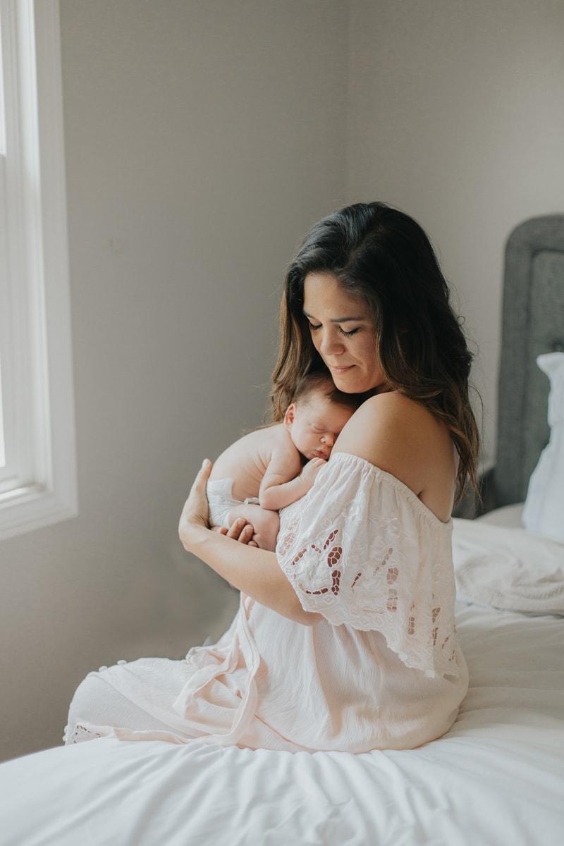Newborn Photographer, baby asleep on mother's chest