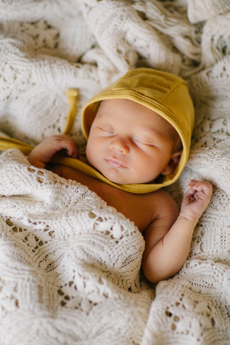 Newborn Photographer, sleeping baby in yellow bonnet