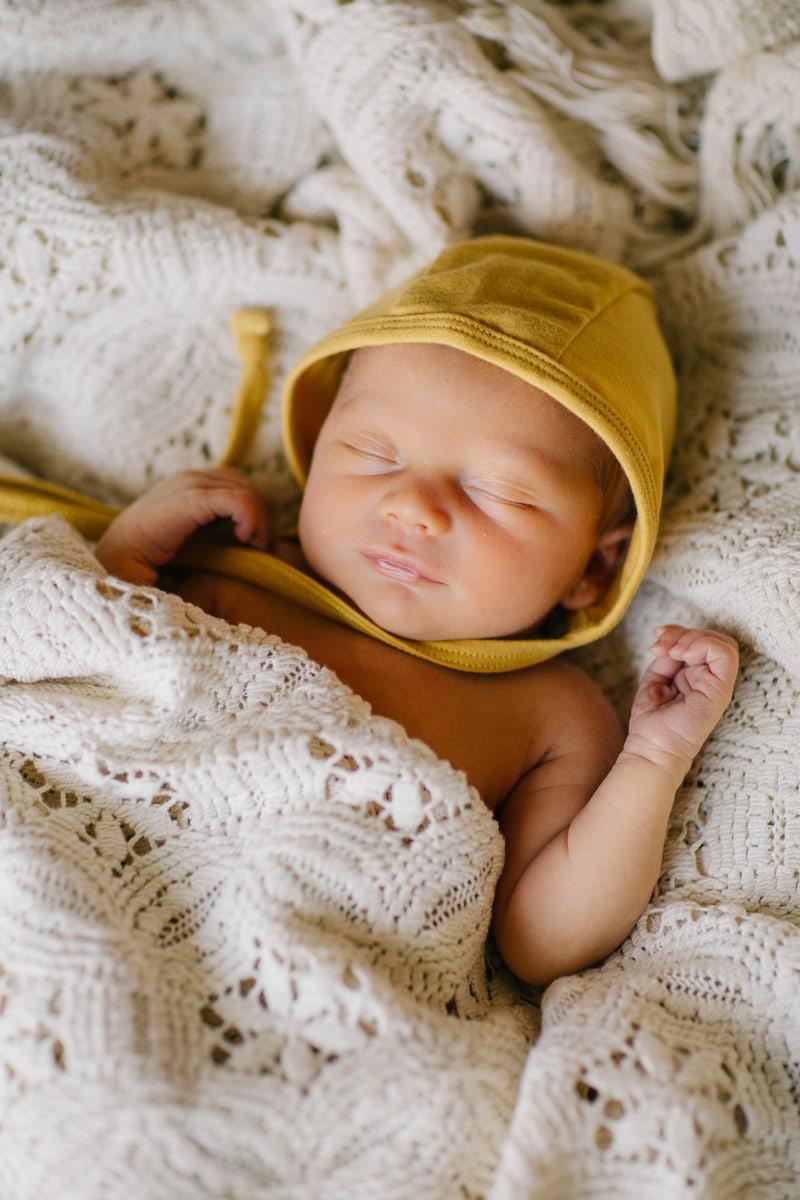 Newborn Photographer, sleeping baby in yellow bonnet